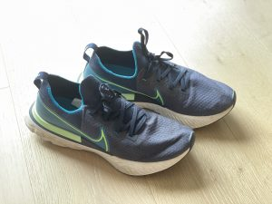comfortable shoes or runners for your meeting - a pair of Nike runners on wood floor in prep of attending a virtual reality meeting